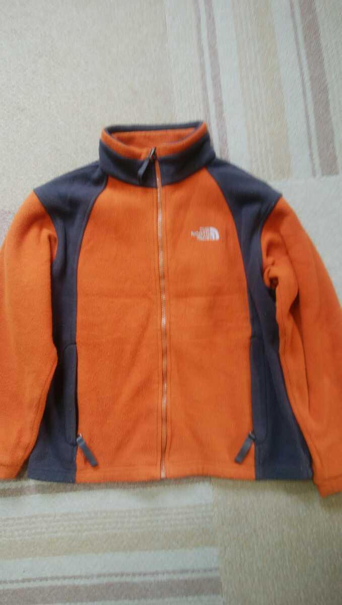 THE NORTH FACE(ザ ノースフェイス)のフリースジャケット カラー:オレンジ系/グレー系 表示サイズ:BOY'S M
