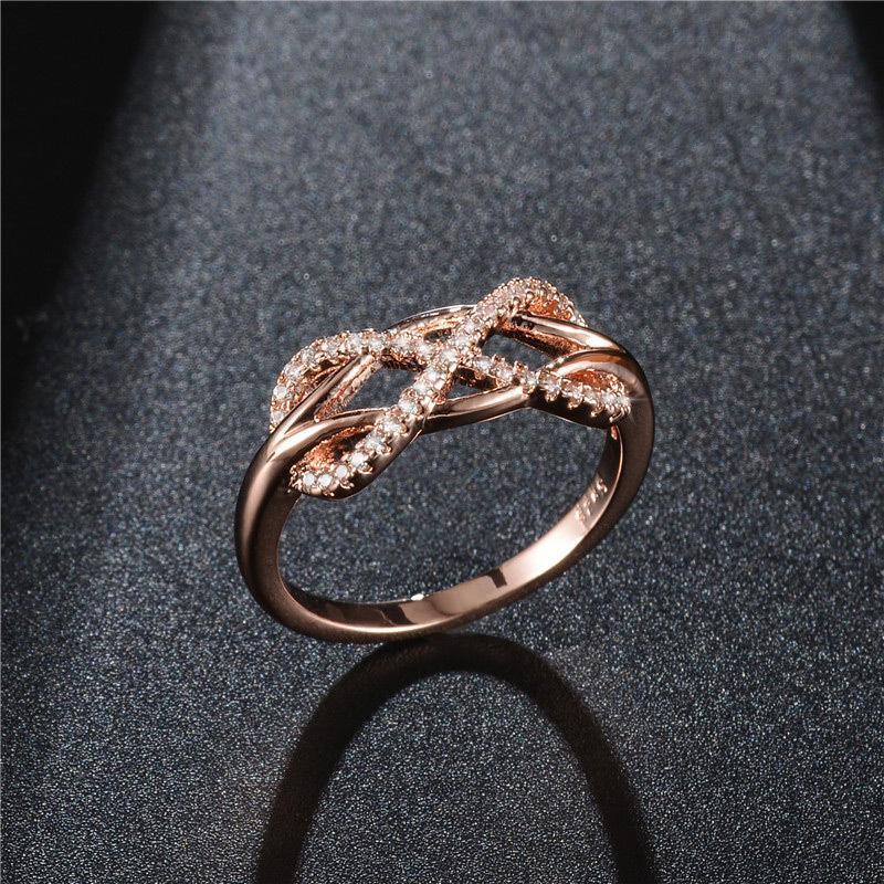ファッションのインフィニティリング aaa + キュービックジルコン cz 石リングローズゴールド/シルバーカラーのウェディングリング_画像1