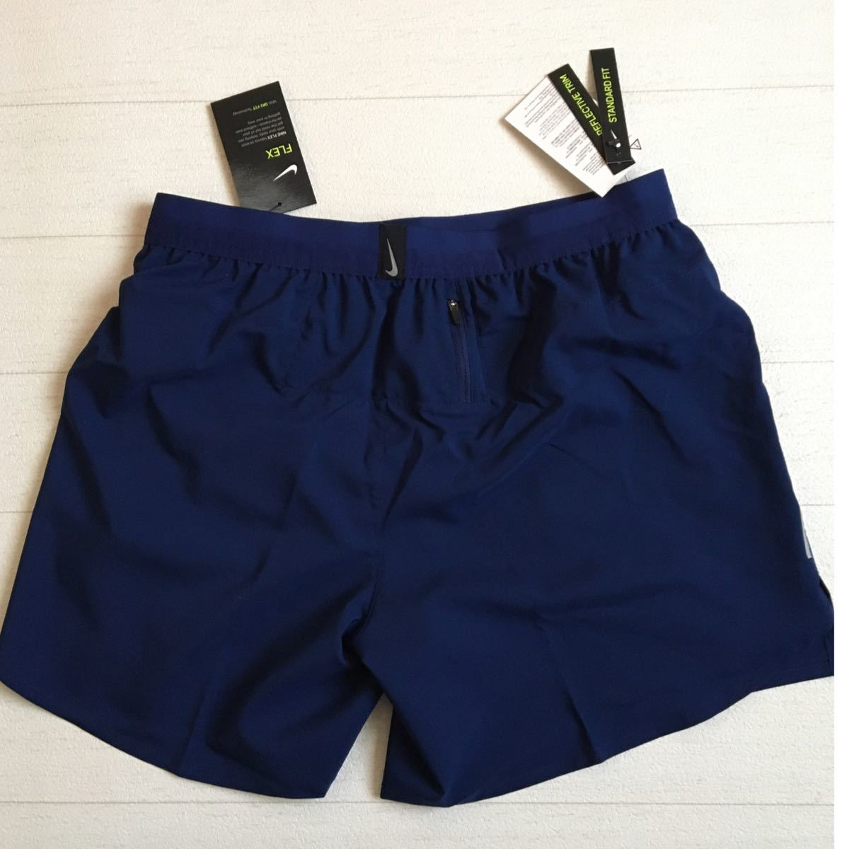 NIKE ランニング ハーフパンツ紺 メンズS 後ろポッケ付き インナーパンツ付