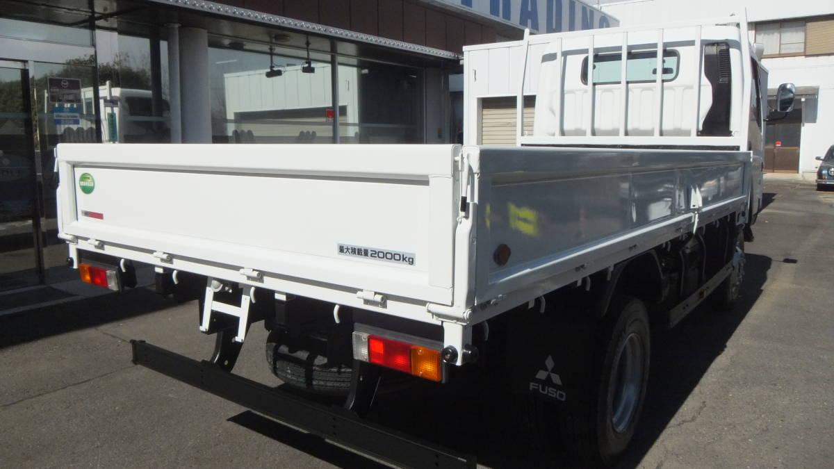 「H25 三菱キャンター 2トントラック 4WD ワイド 平ボディ 最大積載2000㎏ 走行距離41,410㎞」の画像3