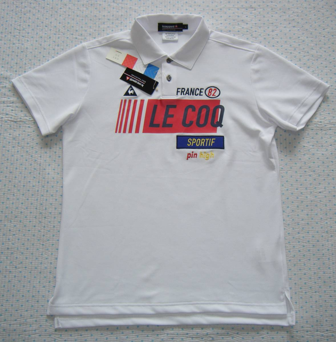 ルコック lecoq FRANCE 82 ゴルフ用高機能/冷感ポロシャツ 白色 サイズ L 吸汗速乾/ストレッチ/UV機能 定価 9,350円_画像1