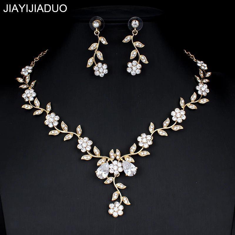 YY0059 古典的なブライダルジュエリーセット 女性のためのドレスアクセサリー ネックレスイヤリングセットゴールド色のウェディングドレス_画像1