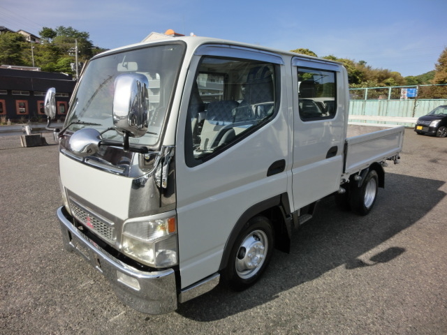 「H17三菱キャンターガッツ1.25tWキャブ全低床4ナンバーターボ付12V2WD(白)(489)(02-22)」の画像1