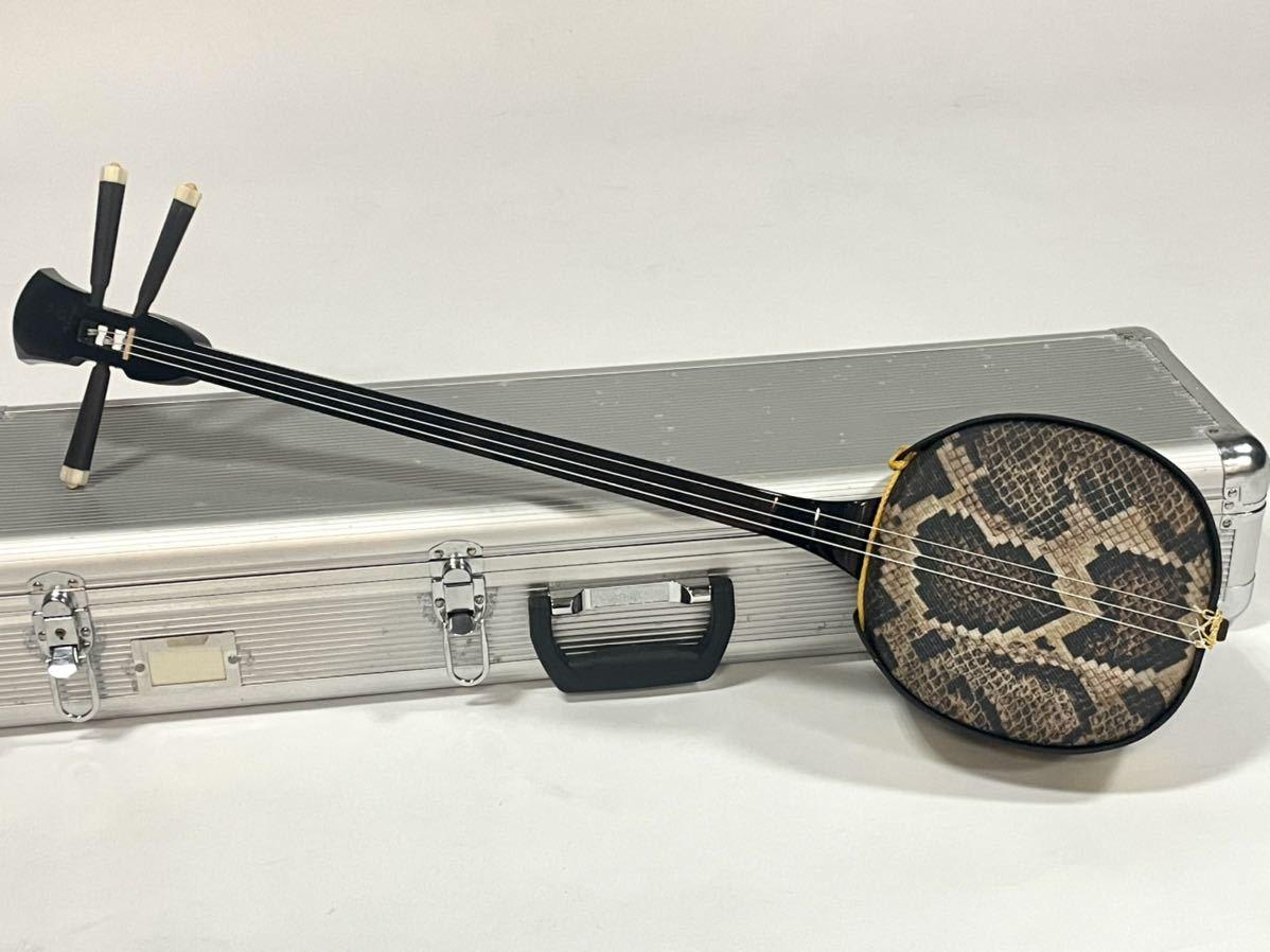 沖縄三線 沖縄三味線 琉球 弦楽器 和楽器 沖縄 縞黒檀 縞黒_画像1