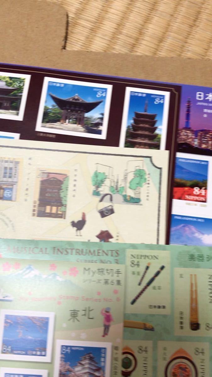 1円ぽすくま、84円(ムーミン・ドラえもん)。シール切手16シート 額面12650円