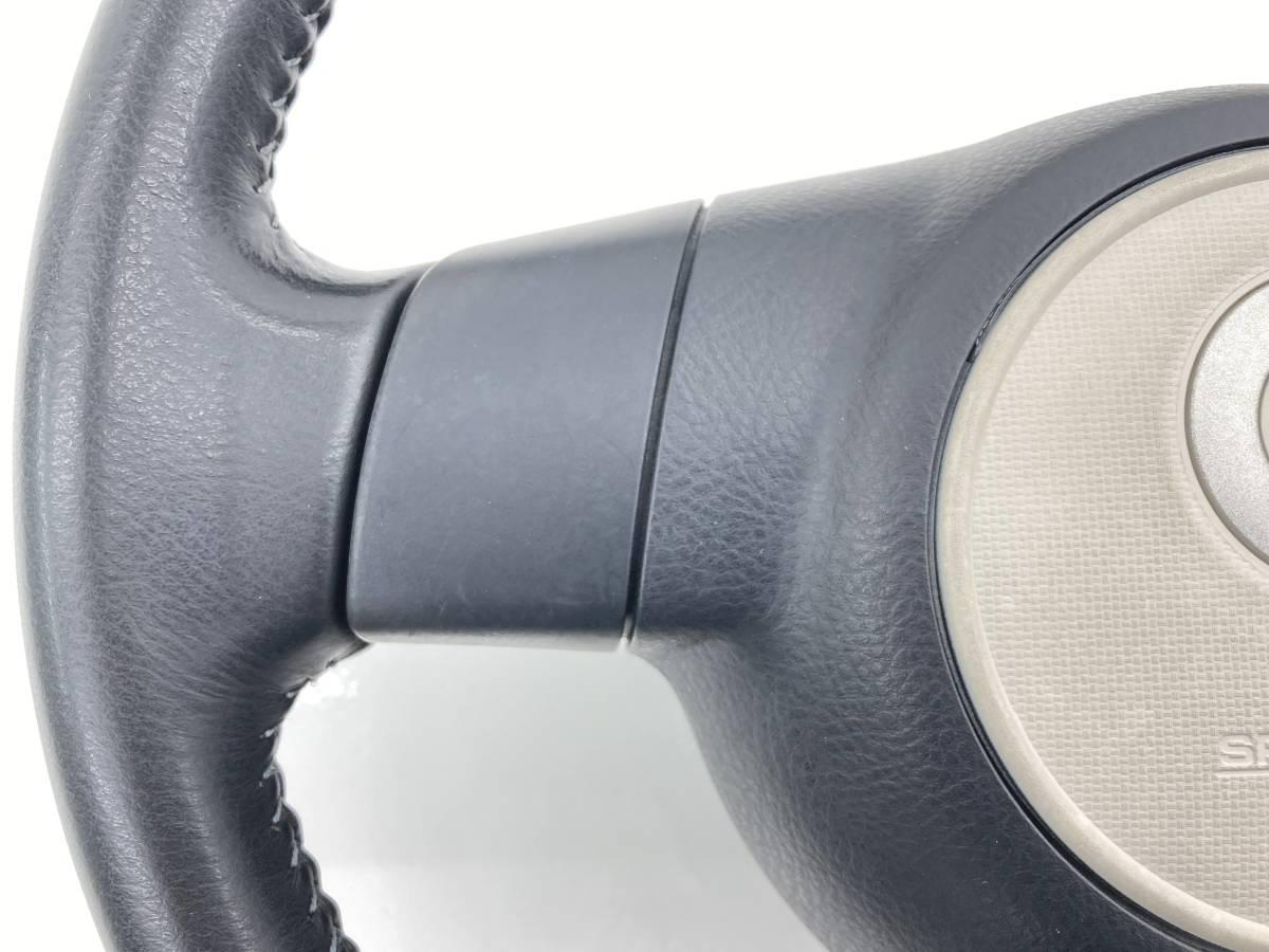 _b58875 ダイハツ ミラココア プラスG DBA-L675S ステアリング ホーンパッド ハンドル レザー 革巻き 未展開 FL10 L685S_画像2