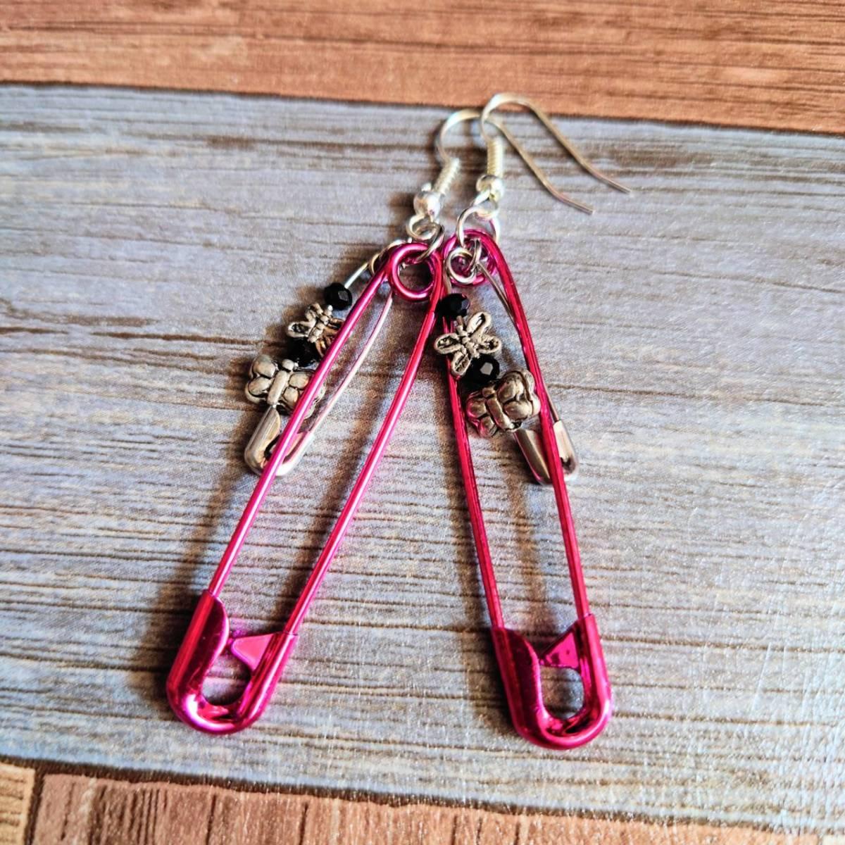 Safety pin piercing pink