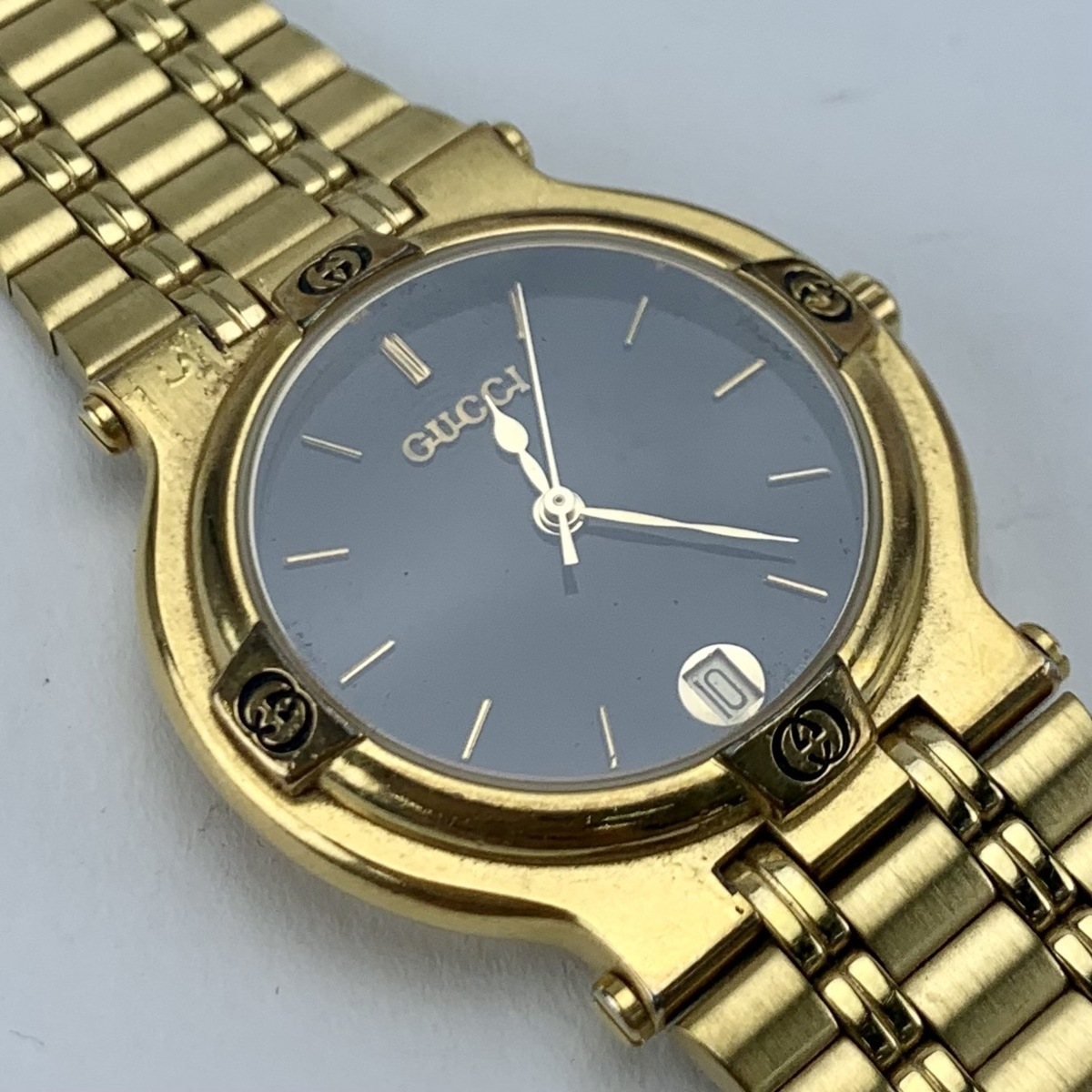 【美品】GUCCI グッチ・ゴールド 腕時計 文字盤ブラック デイ レディース