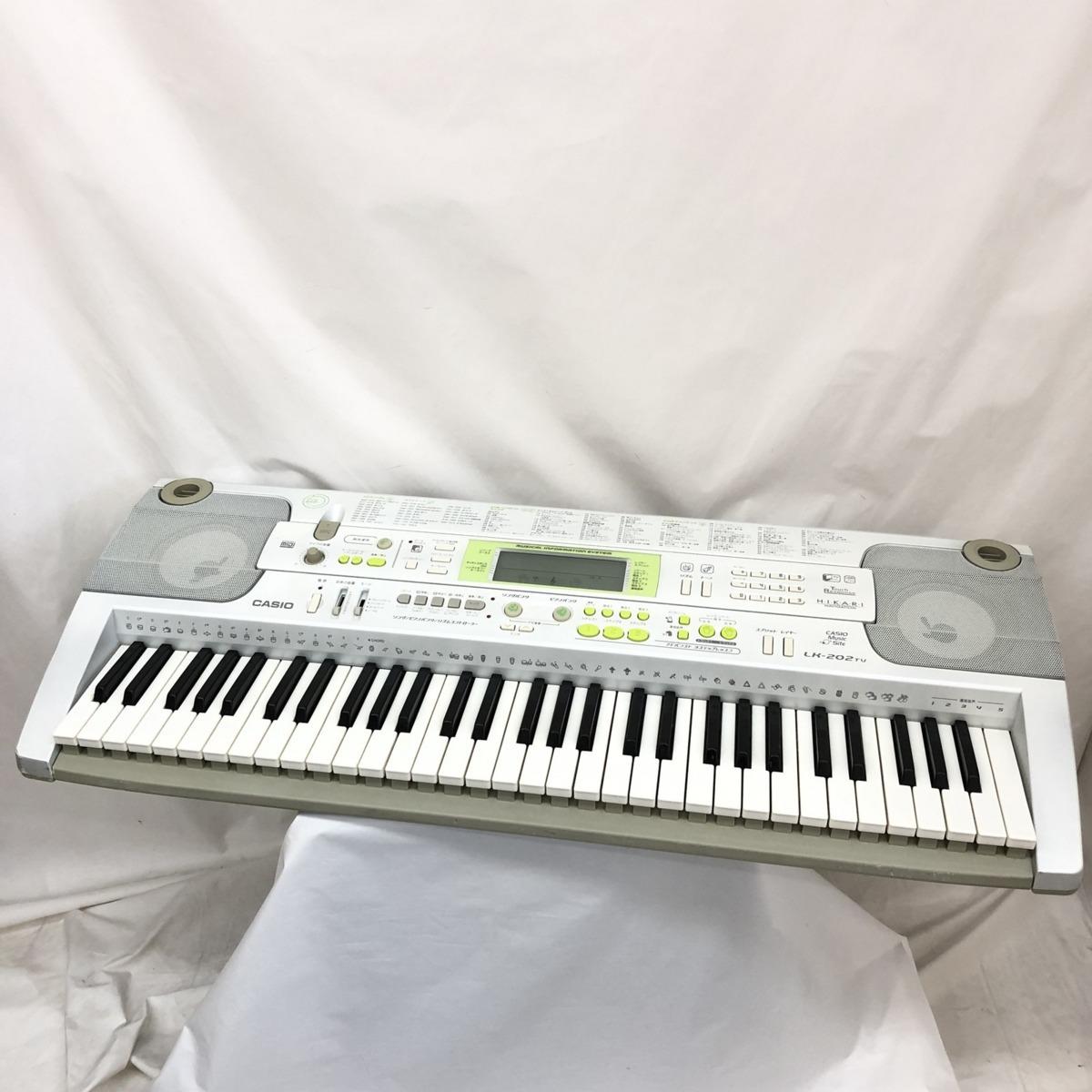 中古 CASIO カシオ 電子キーボード 光ナビゲーション LK-202TV 61鍵盤 シルバー グリーン 電子ピアノ 鍵盤楽器 アダプター 難あり H15233_画像1