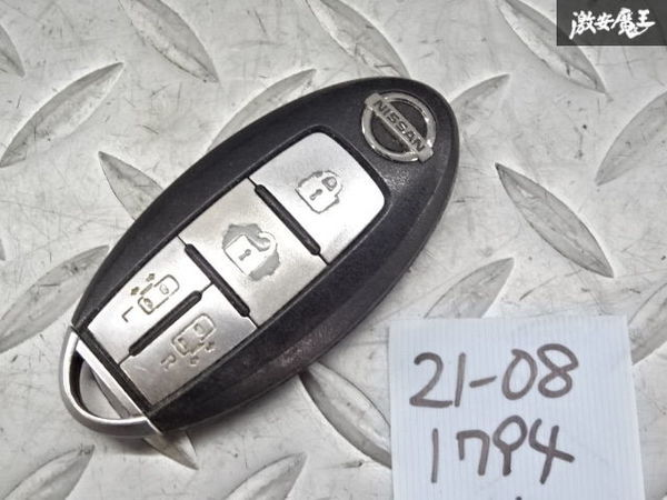日産純正 スマートキー インテリジェントキー キーレス 鍵 カギ 両側スライド BPA0M-11 4ボタン 車種不明 ジャンク 棚2A58_画像1