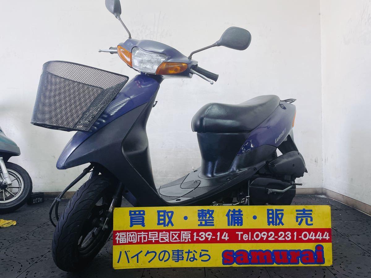 「SUZUKI レッツ2 CA1PA 実動馬力の2サイクル原付バイク 通勤通学にオススメ 足に最適 便利なカゴ付き 福岡市内発どこでも陸送可能」の画像1