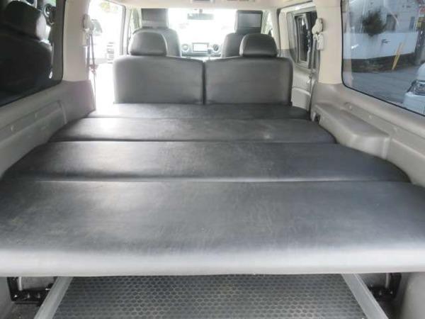 「NV350キャラバン 2.5 プレミアムGX ロングボディ ディーゼルターボ 4WD スライドフロア ベッドキット」の画像3