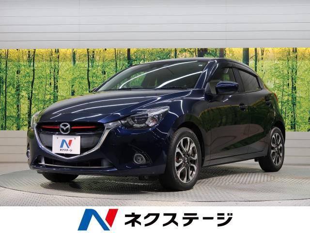 「平成27年 デミオ 1.5 XD ツーリング @車選びドットコム」の画像1