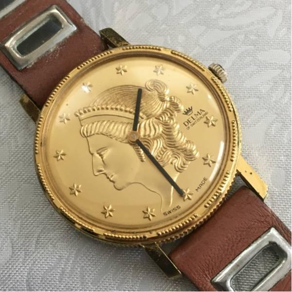 珍しいデザイン! 手巻き delma スイス製 腕時計 ゴールド 硬貨 女性像 稼働品 デルマ