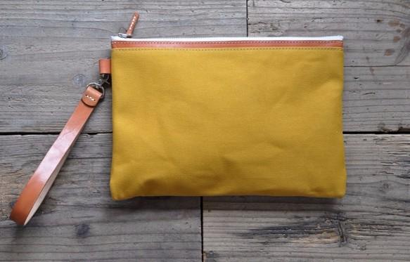 ■ハンドメイドの倉敷帆布とヌメ革のクラッチバッグ(マスタード)_画像1