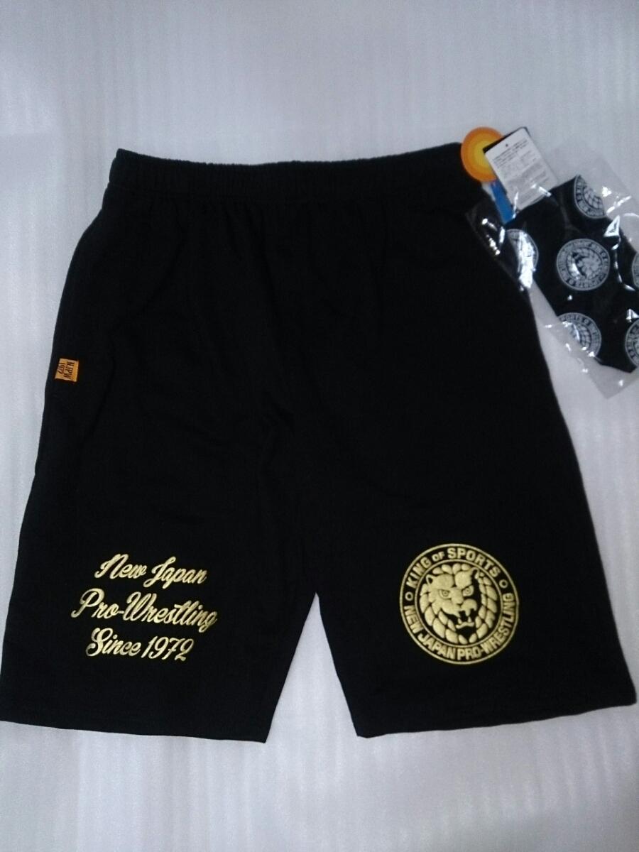新日本プロレス 新品タグ付き ハーフパンツ ポケット3つ ペットボトルホルダー 巾着袋付き M スウェットパンツ 黒 グッズの画像