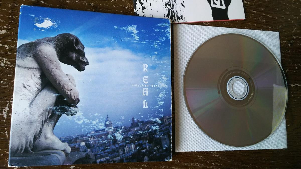 L' Arc-en-Ciel アルバムCD REAL【紙ケースに傷み】_画像2
