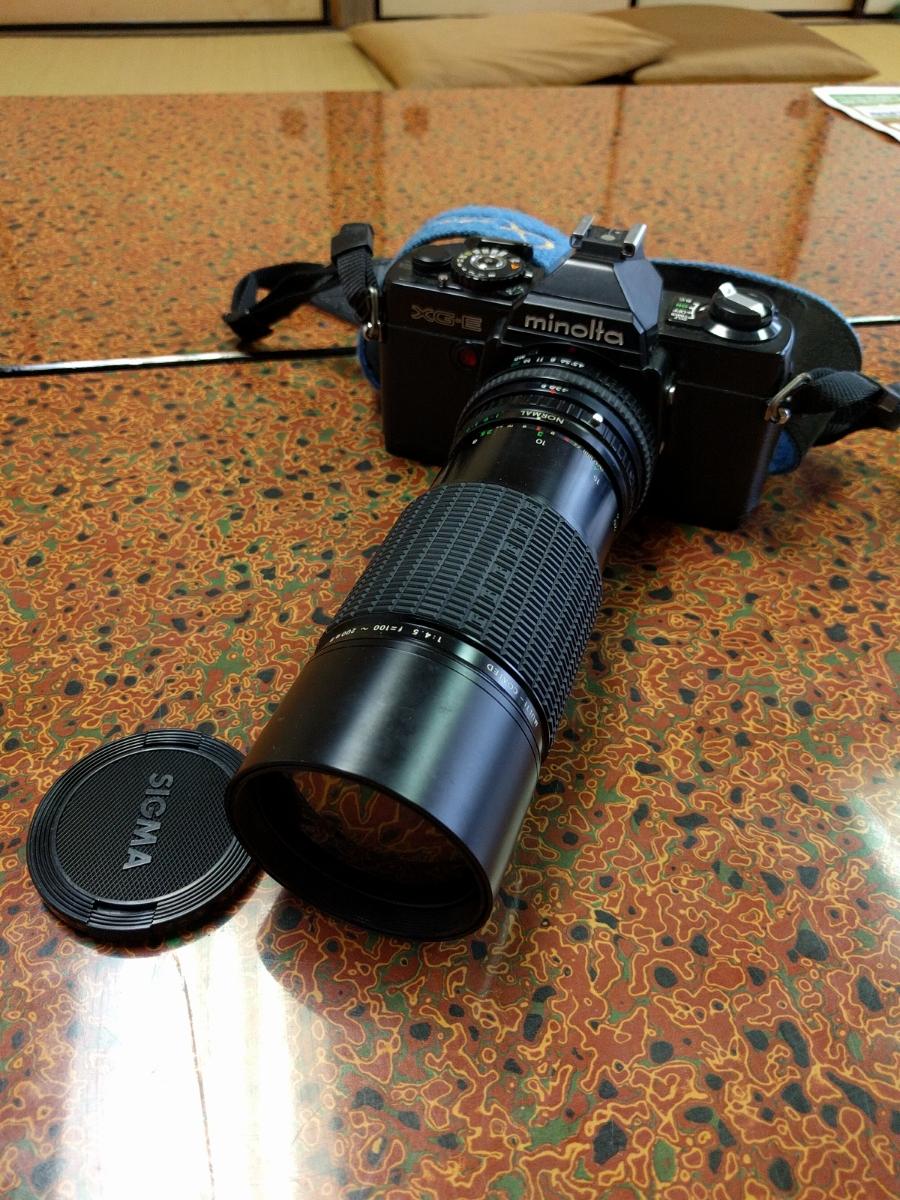 ○MINOLTA ミノルタ XG-E カメラ+シグマ 100-200mm 1:4.5 レンズ (MB-43)