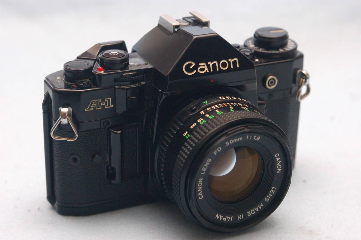 Canon キャノン 昔の高級一眼レフカメラ A-1ボディ + 純正 単焦点50mmレンズ 付