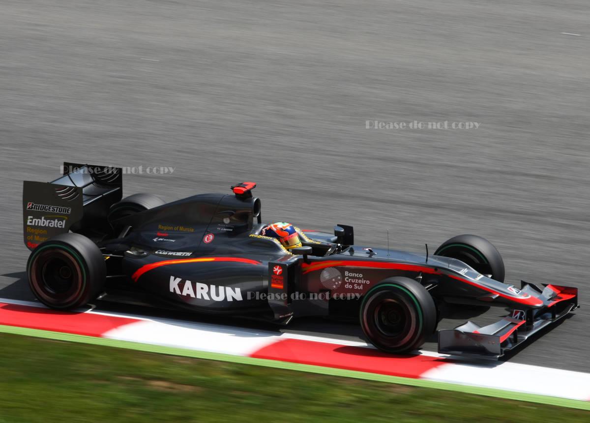 2010年 HRT F1 フォーミュラ1 ヒスパニアレーシング F110 カルン・チャンドック フォト 5枚付き ⑤_画像4