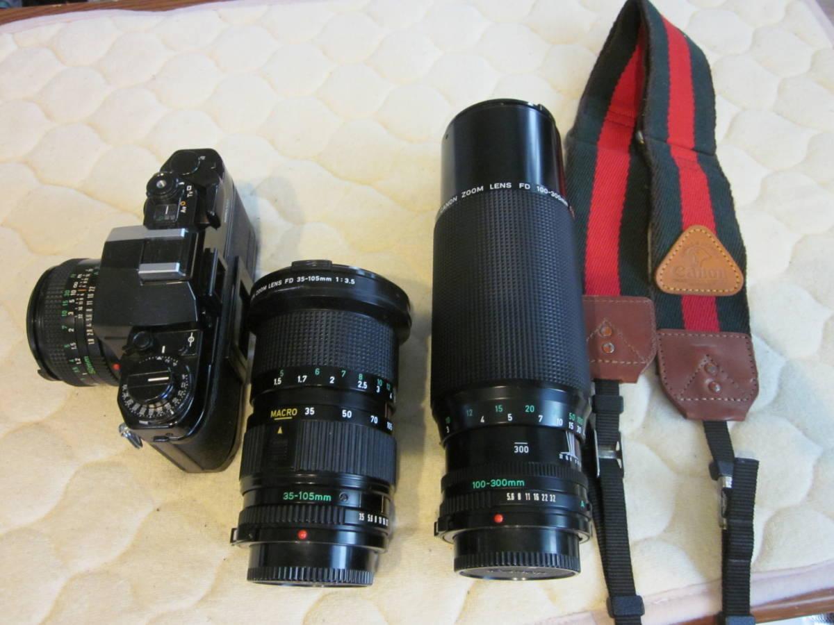 ジャンク品にて、Canon キヤノン A-1 、NFD 50mm F1.8,35-105㎜,100―300㎜ 当時ものストラップ付