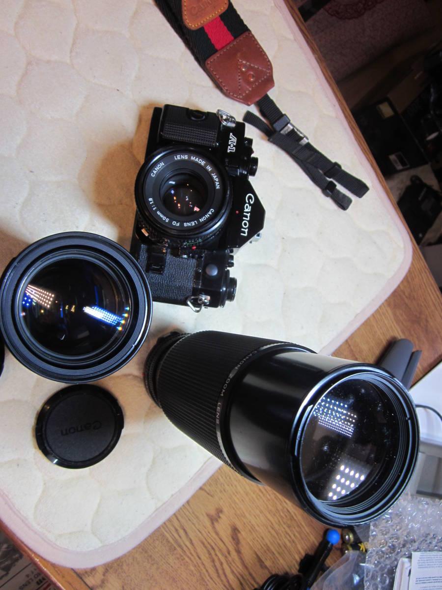 ジャンク品にて、Canon キヤノン A-1 、NFD 50mm F1.8,35-105㎜,100―300㎜ 当時ものストラップ付_画像3