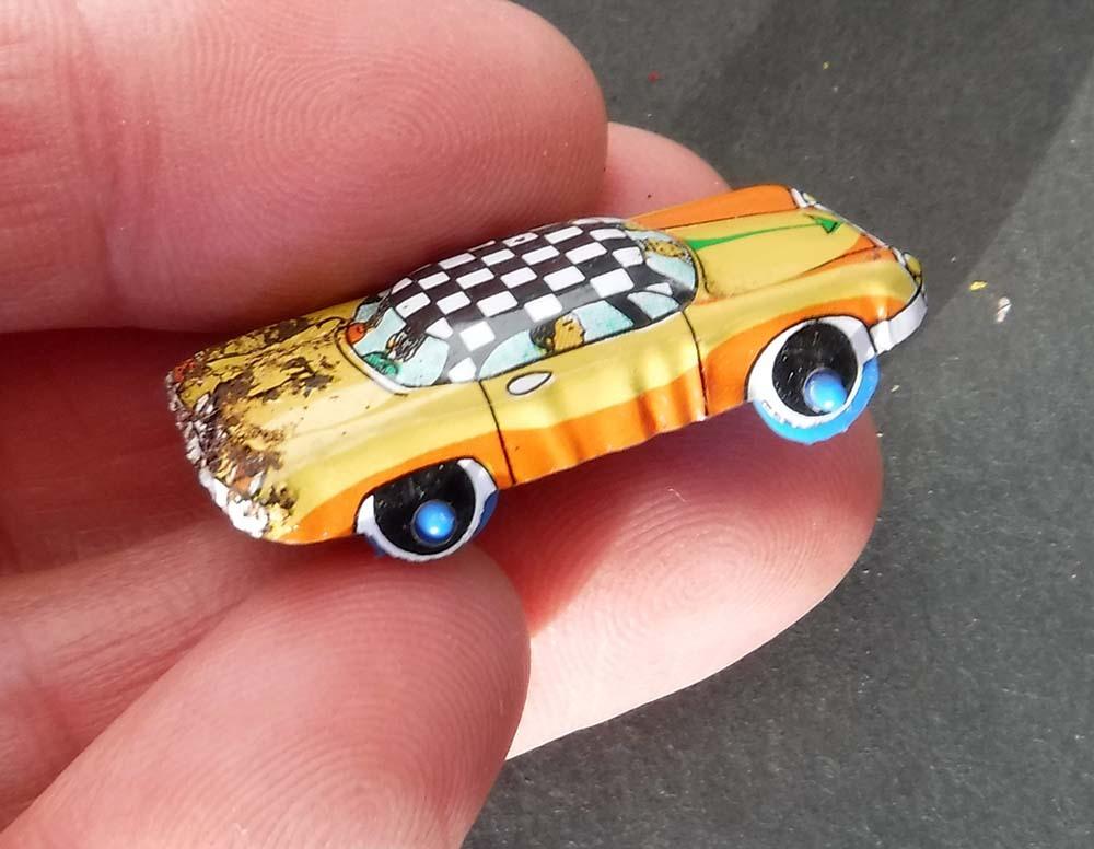 小さく懐か しい日本製ブリキのオモチャ自動車キャラクター昭和レトロ玩具スタントカー車タクシー営業車ミニカージャンクです。_画像4