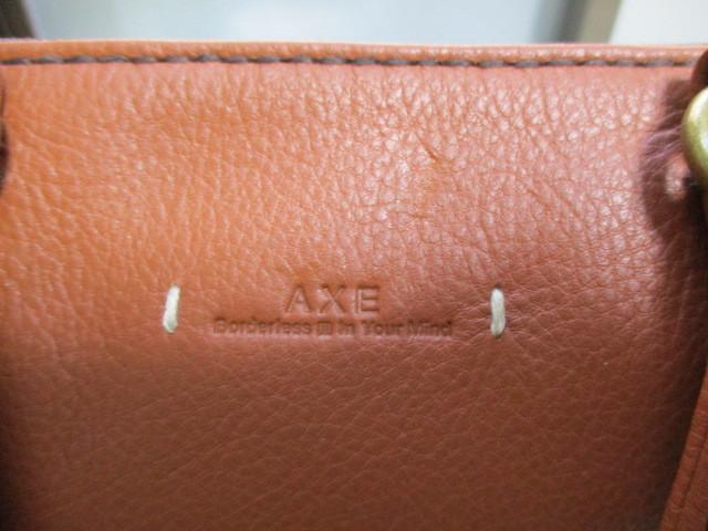 新品★AXE★牛革と綿製★リュックサックにもショルダーバッグにもトートーバッグにもなる3wayバッグ★定価税込32,400円_「AXE」との刻印があります。