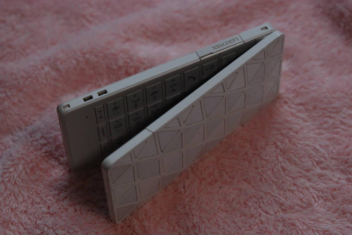 未使用 53TSUAA 電池パック   さらにオマケとしてLIGHT POOL 本体(ジャンク扱い)+使用中の電池+MICROSD 4GB+充電器等_画像4