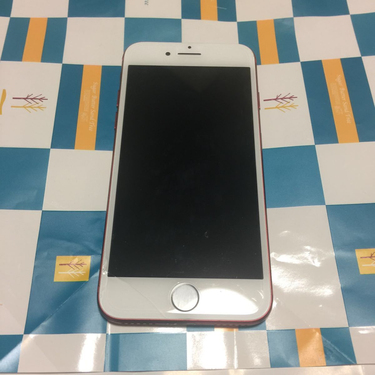 au iPhone 7 128GB (PRODUCT) レッド 本体 携帯 中古 スマホ apple アップル[ ジャンク] 送料無料。 全体 全体的に状態が悪い。
