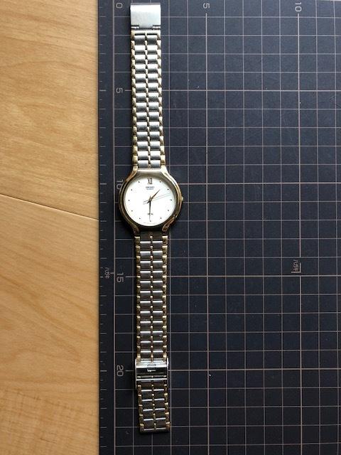 KK518 稀少 レア ヴィンテージ SEIKO/セイコー SX コンビ×ホワイト系文字盤 刻印入純正ブレス V701-6K00 クオーツ メンズ 腕時計_画像2