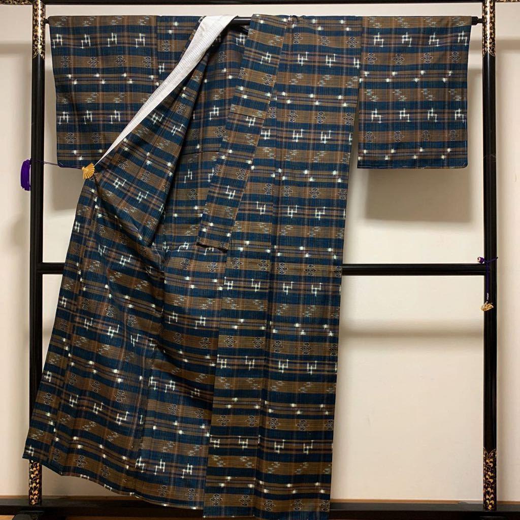 逸品 本場琉球絣 横段絣文様の単衣紬 未使用品 正絹_画像5