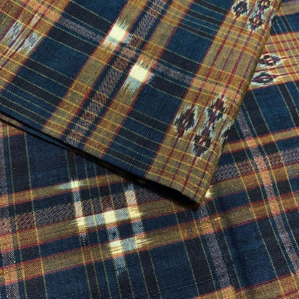 逸品 本場琉球絣 横段絣文様の単衣紬 未使用品 正絹