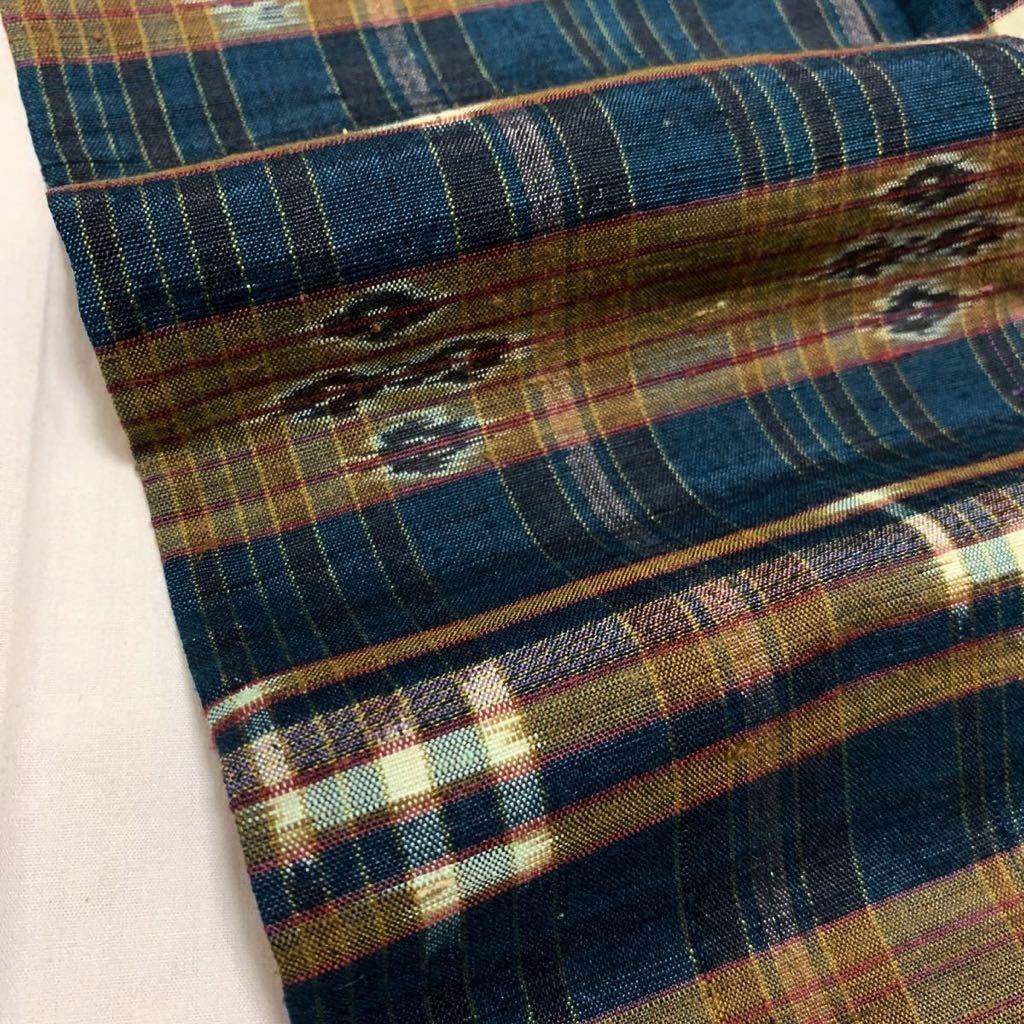 逸品 本場琉球絣 横段絣文様の単衣紬 未使用品 正絹_画像10