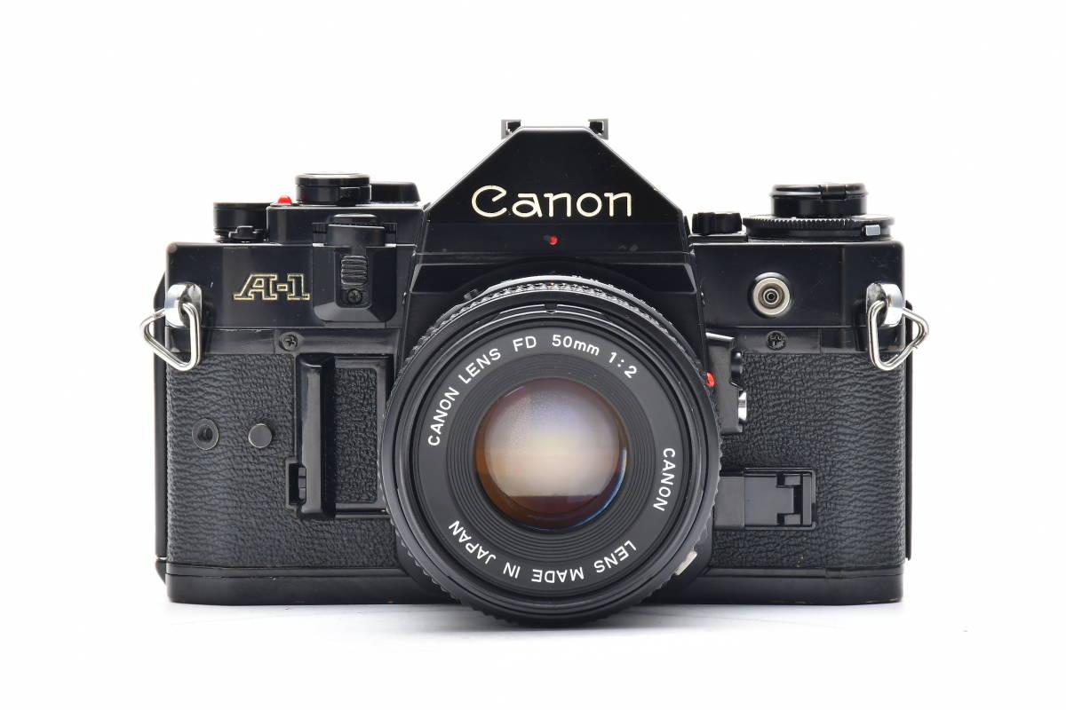 #101 ● Canon キヤノン A-1 + New FD 50mm F2 MF一眼レフ フイルムカメラ