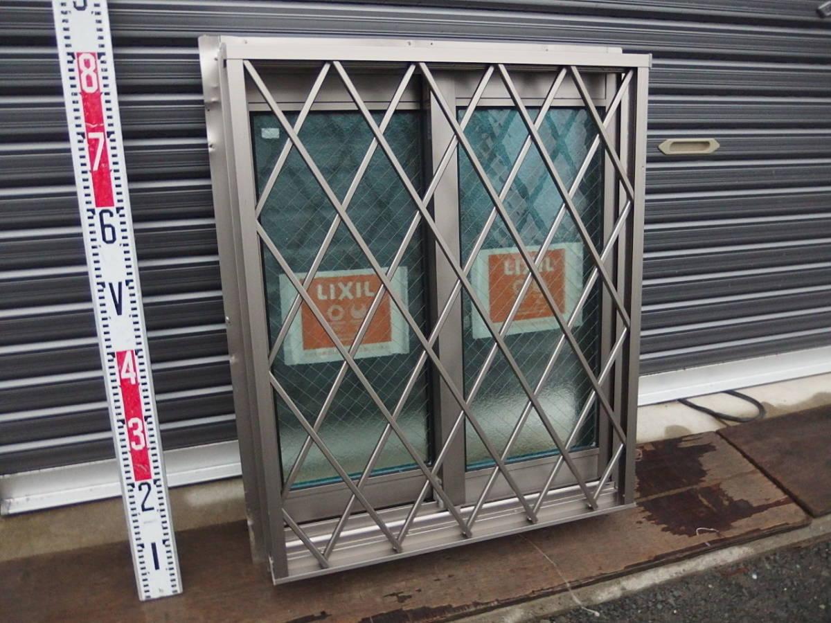 在庫品 アルミサッシ LowE ペアガラス 引違い窓 05707(06007)シャイングレー ヒシクロス格子