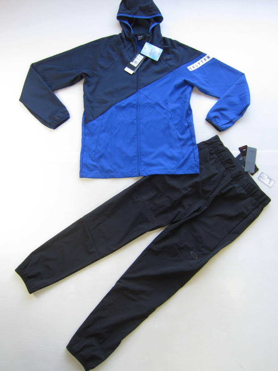 新品◆オークリーOAKLEY トレーニング ジャケット & ロング パンツ M 吸汗速乾ウェア トレーニング 上下セット ブルー 黒 検/ パーカーL