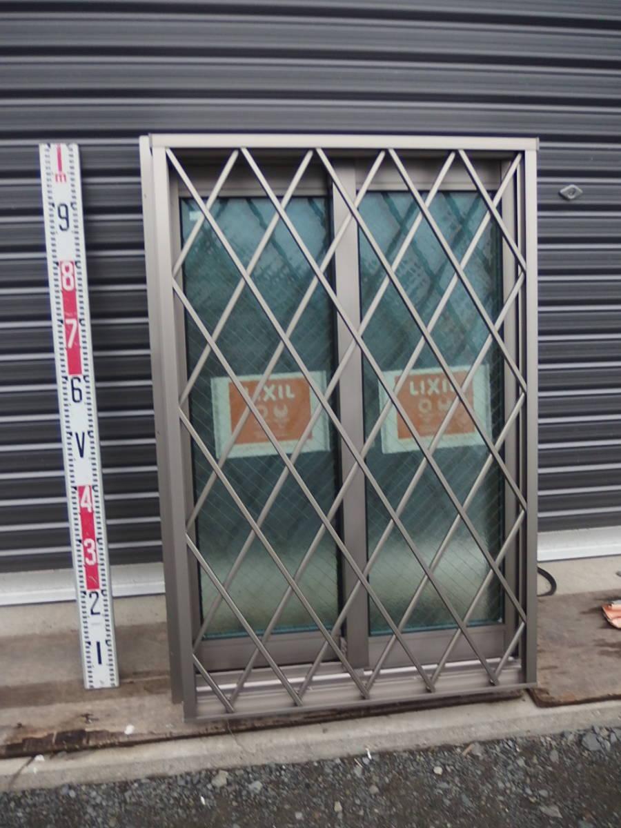 在庫品 アルミサッシ LowE ペアガラス 引違い窓 05709 (06009) ヒシクロス格子 シャイングレー