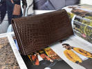 man. stylish gentleman with translation both sides crocodile original leather one sheets leather folding twice purse long wallet men's for man leather Brown tea present