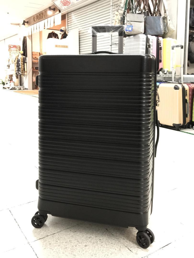 大型軽量スーツケース 8輪キャリーバッグ TSAロック付き Lサイズ 黒_画像1