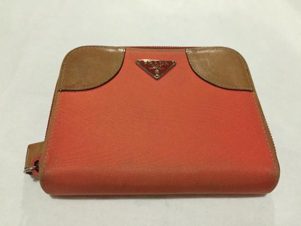 d3599b85fbbd PRADA orange series nylon × leather change purse . folding twice purse